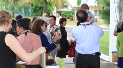 Friends Mingle and Laugh at Community Event on Guam Stock Footage