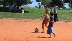 Brazilian indigenous kids playing soccer, Brazil  Stock Footage