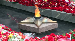 Eternal flame and flowers in memory of the Victory in the Great Patriotic War Stock Footage