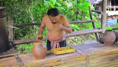 Local villager making rice wine using traditional, native methods Stock Footage
