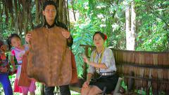 Tour guide explains native methods for producing traditional handicrafts Stock Footage