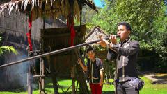 Professional tour guide demonstrates the use of a traditional, blowgun Stock Footage