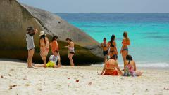 SIMILANS, THAILAND - CIRCA FEB 2015: Tourists relaxing in the leigh of a mass Stock Footage