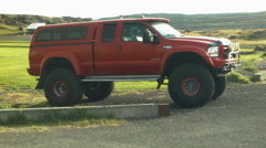 Huge Red Vehicle, mega cab, long box in ICELAND Stock Footage
