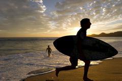 Surfer Boy Surf Board Sunset Silhouette Stock Photos