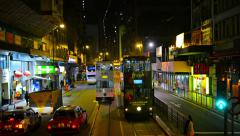 Riding a trolley along a downtown, urban street in Hong Kong, China at night. Stock Footage