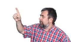 middle-aged man pointing with finger - stock photo
