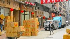 HONG KONG, CHINA - CIRCA JAN 2015: Early morning shoppers stroll amongst boxe Stock Footage