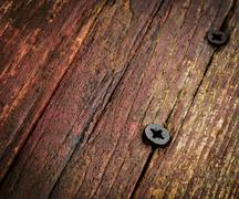 Stock Photo of Two screw in old wood