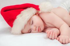 Small boy sleeping in a New Year's cap Stock Photos