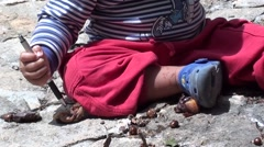 Toddler plays with rotten fruits on the flagstones 2 Stock Footage