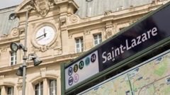 Gare Saint Lazare close up establishing shot of metro sign and building Stock Footage