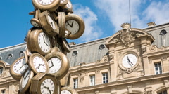 Many clocks, different times with the clock of Saint Lazare in the background. - stock footage
