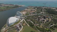 Overlooking view of Gardens by the Bay with cargo boats in background Stock Footage