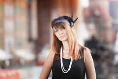 Flapper girl woman in1920s style portrait outdoor Stock Photos
