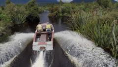Jetboat accelerating away with camera following behind. Stock Footage