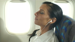 Business woman relaxing on a plane Stock Footage