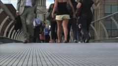 People walking across the London Millennium Footbridge Stock Footage