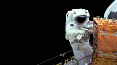 Astronaut working in space Stock Footage