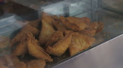 Traditional indian fried samosa in open street shop in India. Stock Footage