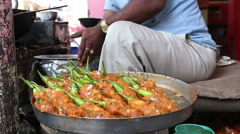 Close view of food preparation at street stall in India. Stock Footage