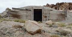 Box of Animal Bones in Badlands Abandoned Uranium Mine Pan Left - stock footage