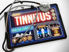 Tinnitus on the Display of Medical Tablet - stock illustration