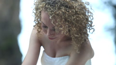 close portrait of bride smiling focus at blonde curly hair - stock footage