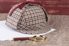 Paper sheets and magnifying glass Stock Photos