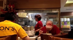 Worker eating food at Chinese restaurant Stock Footage
