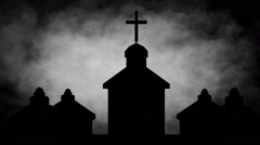Clouds behind silhouetted church buildings - stock footage
