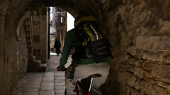 Cycling through the old town of Split Croatia Stock Footage