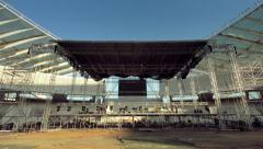 Music stage construction buildup timelapse motion control tilt day to night 25p Stock Footage