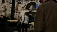 Tilt from crowd to the old wall and Cathedral of Saint Domnius in Split, Croatia Stock Footage