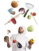 Juggle while cooking - stock photo