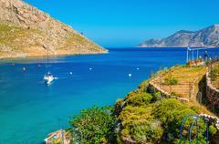 Greek Island Sea bay and yacht on anchor, Greece Stock Photos