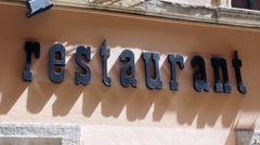 Restaurant signboard - stock photo