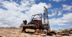 Abandoned Old Drilling Truck in Badlands Locked Shot Stock Footage