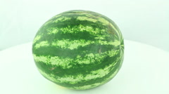Watermelon rotates on a white background Stock Footage
