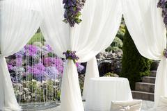 Festive wedding decoration of white fabric closeup - stock photo