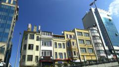 Contrast of historical houses and glass curtain buildings at Tarlabasi just befo Stock Footage