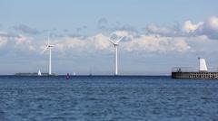 Wind turbines at sea - stock footage