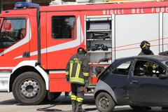 firefighters and relieve the injured in car - stock photo