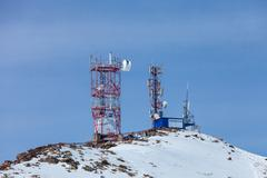 Telecommunication tower on top of the mountain Stock Photos