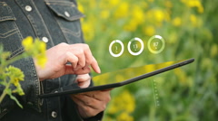 Female Farmer using Digital Tablet Computer in Rapeseed Cultivated Field Stock Footage