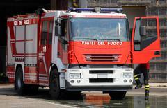 Italian red fire trucks with sirens blue ready for emergency Kuvituskuvat