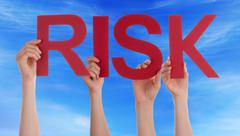 Hands Holding Red Straight Word Risk Blue Sky - stock photo