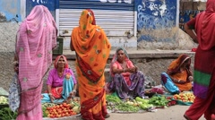 Indian people buying and selling vegetables and fruit at market on the street Stock Footage