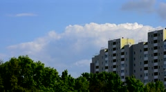 Beautiful clouds move behind modern high rise building Stock Footage