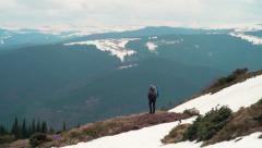 Hiker trekking in mountains Stock Footage